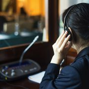 simultaneous interpreter in booth 180x180 - ۵ روش آسان برای بهبود کیفیت ترجمه